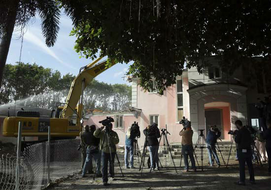 <div class='meta'><div class='origin-logo' data-origin='none'></div><span class='caption-text' data-credit='AP Photo/ Lynne Sladky'>A bulldozer demolishes the waterfront mansion formerly owned by Colombian drug lord Pablo Escobar, Tuesday, Jan. 19, 2016, in Miami Beach, Fla.</span></div>