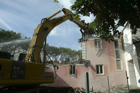 <div class='meta'><div class='origin-logo' data-origin='none'></div><span class='caption-text' data-credit='AP Photo/ Lynne Sladky'>A bulldozer demolishes the waterfront mansion formerly owned by Colombian drug lord Pablo Escobar, Tuesday, Jan. 19, 2016, in Miami Beach.</span></div>