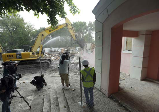 <div class='meta'><div class='origin-logo' data-origin='none'></div><span class='caption-text' data-credit='AP Photo/ Lynne Sladky'>An excavator demolishes the waterfront mansion formerly owned by Colombian drug lord Pablo Escobar, Tuesday, Jan. 19, 2016, in Miami Beach.</span></div>