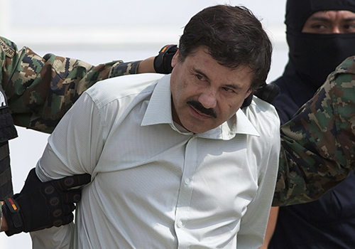 <div class='meta'><div class='origin-logo' data-origin='AP'></div><span class='caption-text' data-credit='AP Photo/Eduardo Verdugo, File'>Joaquin &#34;El Chapo&#34; Guzman is escorted to a helicopter in Mexico City following his capture overnight in the beach resort town of Mazatlan in 2014.</span></div>