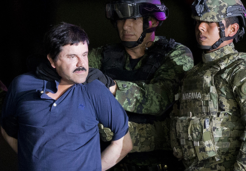 "<div class=""meta image-caption""><div class=""origin-logo origin-image ap""><span>AP</span></div><span class=""caption-text"">Joaquin ""El Chapo"" Guzman is made to face the press as he is escorted to a helicopter by Mexican soldiers and marines at a federal hangar in Mexico City in 2016. (AP Photo/Eduardo Verdugo, File)</span></div>"