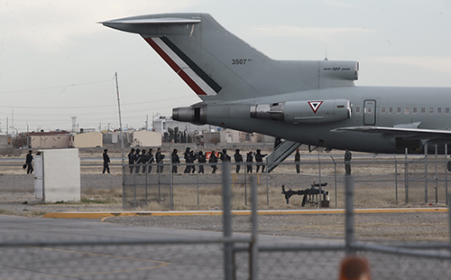 <div class='meta'><div class='origin-logo' data-origin='AP'></div><span class='caption-text' data-credit='AP Photo/Christian Torres'>Police board Mexican Air Force plane after the extradition of drug lord Joaquin &#34;El Chapo&#34; Guzman in Ciudad Juarez, Mexico, Thursday, Jan. 19, 2017.</span></div>