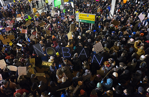 <div class='meta'><div class='origin-logo' data-origin='AP'></div><span class='caption-text' data-credit='AP Photo/Craig Ruttle'>Protesters assemble at John F. Kennedy International Airport in New York after earlier in the day two Iraqi refugees were detained while trying to enter the country.</span></div>