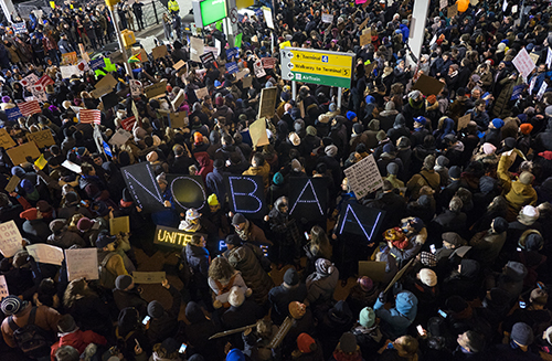<div class='meta'><div class='origin-logo' data-origin='AP'></div><span class='caption-text' data-credit='AP Photo/Craig Ruttle'>Protesters assemble at John F. Kennedy International Airport in New York, Saturday, Jan. 28, 2017, after earlier in the day two Iraqi refugees were detained.</span></div>
