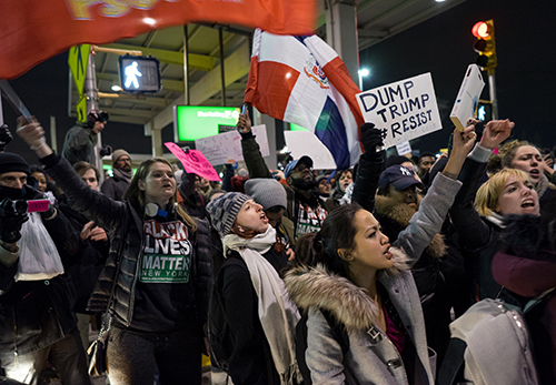 <div class='meta'><div class='origin-logo' data-origin='AP'></div><span class='caption-text' data-credit='AP Photo/Craig Ruttle'>Protesters block an intersection near Terminal 4 at John F. Kennedy International Airport in New York, Saturday, Jan. 28, 2017.</span></div>