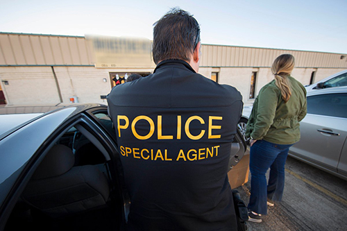 <div class='meta'><div class='origin-logo' data-origin='none'></div><span class='caption-text' data-credit='Immigration & Customs Enforcement/Twitter'>ICE's HSI special agents arrive on scene at the target location suspected of peddling counterfeit merchandise.</span></div>