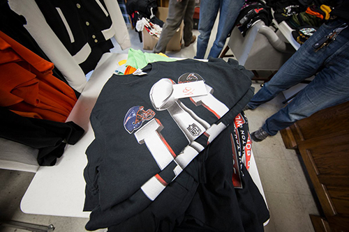 <div class='meta'><div class='origin-logo' data-origin='none'></div><span class='caption-text' data-credit='Immigration & Customs Enforcement/Twitter'>Houston police seizes counterfeit t-shirts.</span></div>
