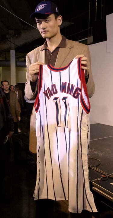 """<div class=""""meta image-caption""""><div class=""""origin-logo origin-image ktrk""""><span>KTRK</span></div><span class=""""caption-text"""">FILE - In this Oct. 20, 2002 file photo, Houston Rockets first round draft pick Yao Ming holds his new game jersey following a news conference. (AP Photo/Brett Coomer, File) (AP)</span></div>"""