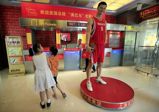 """<div class=""""meta image-caption""""><div class=""""origin-logo origin-image ktrk""""><span>KTRK</span></div><span class=""""caption-text"""">Young visitor walks past a wax figure of Houston Rockets' Yao Ming at Madame Tussauds Wax Museum Wednesday July 1, 2009 in Shanghai, China. (AP Photo/Eugene Hoshiko) (ASSOCIATED PRESS)</span></div>"""