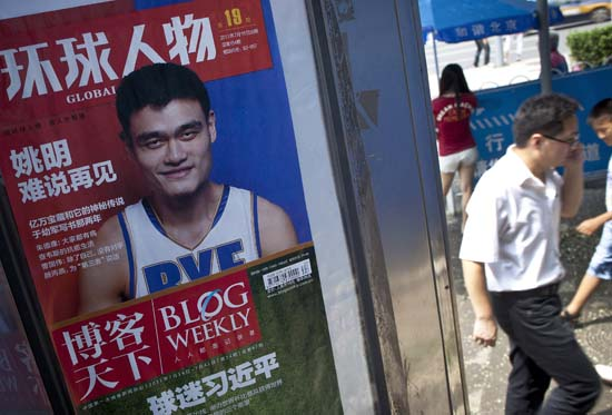 """<div class=""""meta image-caption""""><div class=""""origin-logo origin-image ktrk""""><span>KTRK</span></div><span class=""""caption-text"""">Pedestrians walks past a magazine poster featuring NBA basketball star Yao Ming at a news stand in Beijing, China, Wednesday, July 20, 2011. (AP Photo/Andy Wong) (AP)</span></div>"""