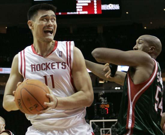 "<div class=""meta image-caption""><div class=""origin-logo origin-image ktrk""><span>KTRK</span></div><span class=""caption-text"">Houston Rockets' Yao Ming (11), of China, looks to shoot as Milwaukee Bucks' Brian Skinner (54) defends during the first quarter. (AP Photo/David J. Phillip) (AP)</span></div>"