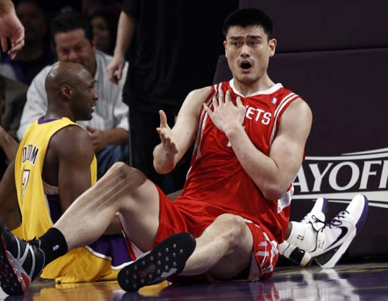 """<div class=""""meta image-caption""""><div class=""""origin-logo origin-image ktrk""""><span>KTRK</span></div><span class=""""caption-text"""">Houston Rockets' Yao Ming, right, of China, reacts to being called for a blocking foul in front of Los Angeles Lakers' Lamar Odom. (AP Photo/Matt Sayles) (ASSOCIATED PRESS)</span></div>"""