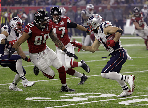 <div class='meta'><div class='origin-logo' data-origin='AP'></div><span class='caption-text' data-credit='AP'>New England Patriots' Julian Edelman runs against Atlanta Falcons' Levine Toilolo on a punt return during the second half of the NFL Super Bowl.</span></div>
