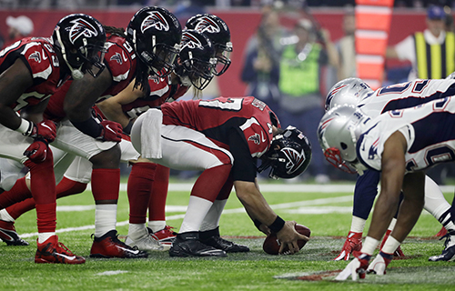 <div class='meta'><div class='origin-logo' data-origin='AP'></div><span class='caption-text' data-credit='AP'>Atlanta Falcons' Josh Harris, center, prepares to shape the ball during the second half of the NFL Super Bowl 51 football game.</span></div>