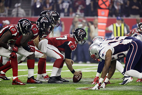 <div class='meta'><div class='origin-logo' data-origin='AP'></div><span class='caption-text' data-credit='AP'>Atlanta Falcons' Josh Harris, center, prepares to shape the ball during the second half of the NFL Super Bowl 51 football game against the New England Patriots.</span></div>