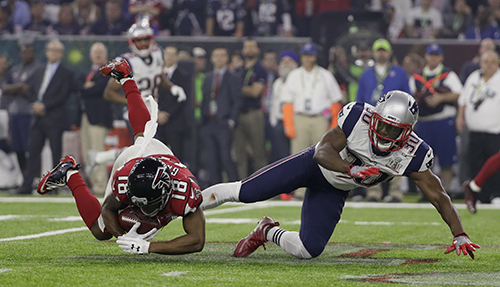 <div class='meta'><div class='origin-logo' data-origin='AP'></div><span class='caption-text' data-credit='AP'>Atlanta Falcons' Taylor Gabriel makes a catch against New England Patriots' Duron Harmon during the second half of the NFL Super Bowl 51 football game Sunday, Feb. 5, 2017.</span></div>