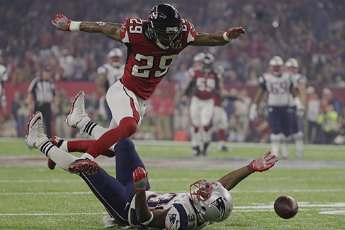 <div class='meta'><div class='origin-logo' data-origin='AP'></div><span class='caption-text' data-credit='AP'>Atlanta Falcons' C.J. Goodwin breaks up a pass intended for New England Patriots' Dion Lewis, during the second half of the NFL Super Bowl 51 football game.</span></div>