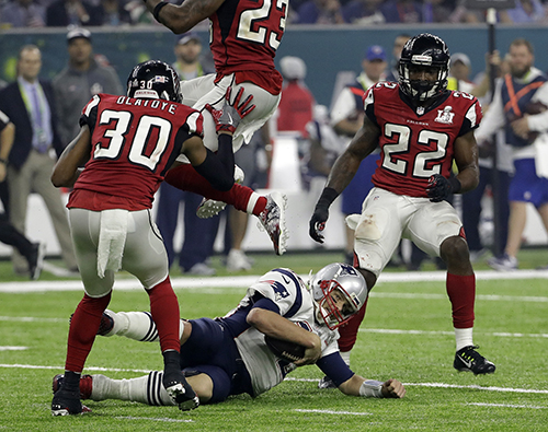 <div class='meta'><div class='origin-logo' data-origin='AP'></div><span class='caption-text' data-credit='AP'>New England Patriots' Tom Brady slides against the Atlanta Falcons defense during the second half of the NFL Super Bowl 51 football game Sunday, Feb. 5, 2017, in Houston.</span></div>