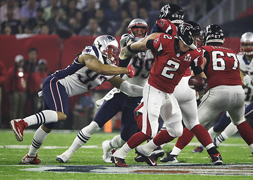 <div class='meta'><div class='origin-logo' data-origin='AP'></div><span class='caption-text' data-credit='AP'>Atlanta Falcons' Matt Ryan (2) breaks loose from New England Patriots' Jabaal Sheard during the second half of the NFL Super Bowl 51 football game.</span></div>