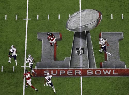 <div class='meta'><div class='origin-logo' data-origin='AP'></div><span class='caption-text' data-credit='AP'>Atlanta Falcons' Devonta Freeman runs against the New England Patriots defense during the first half of the NFL Super Bowl 51 football game Sunday, Feb. 5, 2017, in Houston.</span></div>