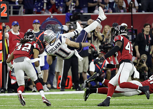 <div class='meta'><div class='origin-logo' data-origin='AP'></div><span class='caption-text' data-credit='AP'>New England Patriots' Julian Edelman (11) is upended by Atlanta Falcons' Philip Wheeler during the first half of the NFL Super Bowl 51 football game Sunday, Feb. 5, 2017.</span></div>