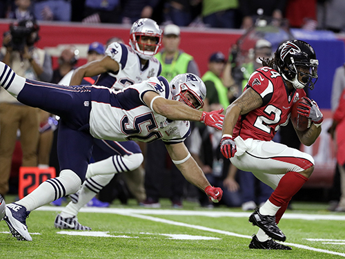 <div class='meta'><div class='origin-logo' data-origin='AP'></div><span class='caption-text' data-credit='AP'>Atlanta Falcons' Devonta Freeman (24) runs against New England Patriots' Rob Ninkovich (50) during the first half of the NFL Super Bowl 51 football game Sunday, Feb. 5, 2017.</span></div>