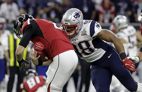 <div class='meta'><div class='origin-logo' data-origin='AP'></div><span class='caption-text' data-credit='AP'>Atlanta Falcons' Matt Ryan is sacked by New England Patriots' Trey Flowers during the first half of the NFL Super Bowl 51 football game Sunday, Feb. 5, 2017, in Houston.</span></div>