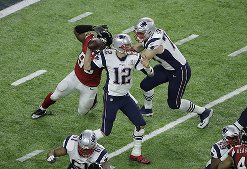 <div class='meta'><div class='origin-logo' data-origin='AP'></div><span class='caption-text' data-credit='AP'>New England Patriots' Tom Brady passes against the Atlanta Falcons during the first half of the NFL Super Bowl 51 football game Sunday, Feb. 5, 2017, in Houston.</span></div>