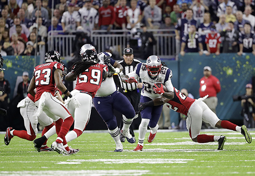 <div class='meta'><div class='origin-logo' data-origin='AP'></div><span class='caption-text' data-credit='AP'>New England Patriots' LeGarrette Blount (29) runs against the Atlanta Falcons during the first half of the NFL Super Bowl 51 football game Sunday, Feb. 5, 2017, in Houston.</span></div>