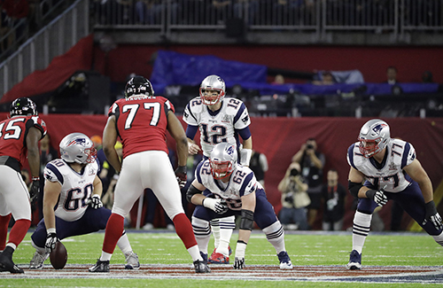 <div class='meta'><div class='origin-logo' data-origin='AP'></div><span class='caption-text' data-credit='AP'>New England Patriots' Tom Brady (12) waits for the snap behind David Andrews (60), New England Patriots' Joe Thuney (62) Nate Solder (77) .</span></div>