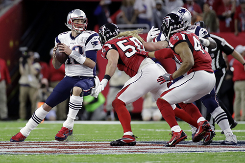<div class='meta'><div class='origin-logo' data-origin='AP'></div><span class='caption-text' data-credit='AP'>New England Patriots' Tom Brady drops back to pass under pressure from Atlanta Falcons' Brooks Reed in the first half of the NFL Super Bowl 51 football game Sunday, Feb. 5, 2017.</span></div>