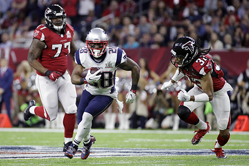 <div class='meta'><div class='origin-logo' data-origin='AP'></div><span class='caption-text' data-credit='AP'>New England Patriots' James White carries past Atlanta Falcons' Jalen Collins, right, and Ra'Shede Hageman, left, in the first half of the NFL Super Bowl 51 football game.</span></div>