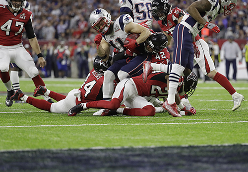 <div class='meta'><div class='origin-logo' data-origin='AP'></div><span class='caption-text' data-credit='AP'>New England Patriots' Julian Edelman (11) is tackled against the Atlanta Falcons during the first half of the NFL Super Bowl 51 football game Sunday, Feb. 5, 2017, in Houston.</span></div>