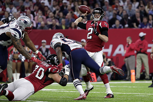 <div class='meta'><div class='origin-logo' data-origin='AP'></div><span class='caption-text' data-credit='AP'>Atlanta Falcons' Matt Ryan passes under pressure as Jake Matthews tries to block for him during the first half of the NFL Super Bowl 51 football game Sunday, Feb. 5, 2017.</span></div>