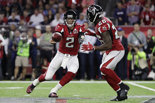 <div class='meta'><div class='origin-logo' data-origin='AP'></div><span class='caption-text' data-credit='AP'>Atlanta Falcons' Matt Ryan hands off to Tevin Coleman, right, during the first half of the NFL Super Bowl 51 football game against the New England Patriots Sunday, Feb. 5, 2017.</span></div>