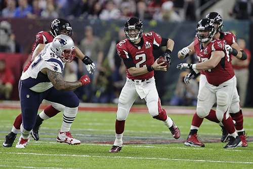<div class='meta'><div class='origin-logo' data-origin='AP'></div><span class='caption-text' data-credit='AP'>Atlanta Falcons' Matt Ryan scrambles with the ball under pressure from New England Patriots' Alan Branch, right, during the first half of the NFL Super Bowl 51 football game.</span></div>