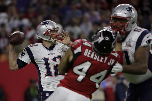<div class='meta'><div class='origin-logo' data-origin='AP'></div><span class='caption-text' data-credit='AP'>New England Patriots' Tom Brady looks too pass during the first half of the NFL Super Bowl 51 football game against the Atlanta Falcons, Sunday, Feb. 5, 2017, in Houston.</span></div>