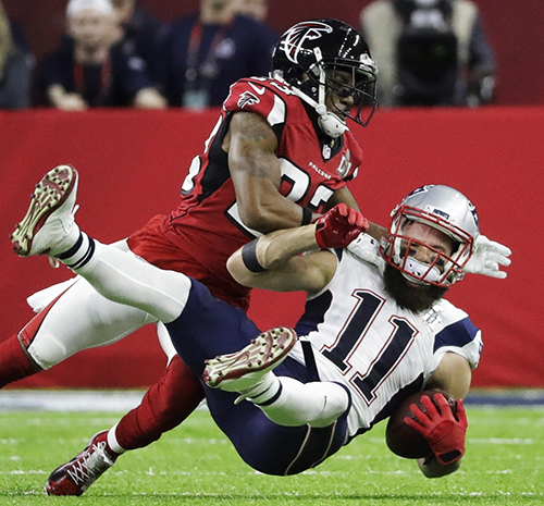 <div class='meta'><div class='origin-logo' data-origin='AP'></div><span class='caption-text' data-credit='AP'>New England Patriots' Julian Edelman is tackled by Atlanta Falcons' Robert Alford during the first half of the NFL Super Bowl 51 football game Sunday, Feb. 5, 2017, in Houston.</span></div>