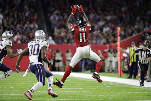 <div class='meta'><div class='origin-logo' data-origin='AP'></div><span class='caption-text' data-credit='AP'>Atlanta Falcons' Julio Jones catches a pass against the New England Patriots during the first half of the NFL Super Bowl 51 football game Sunday, Feb. 5.</span></div>