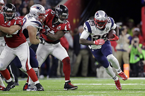 <div class='meta'><div class='origin-logo' data-origin='AP'></div><span class='caption-text' data-credit='AP'>New England Patriots' LeGarrette Blount carries past Atlanta Falcons' Jonathan Babineaux, center, during the first half of the NFL Super Bowl 51 football game Sunday, Feb. 5, 2017.</span></div>