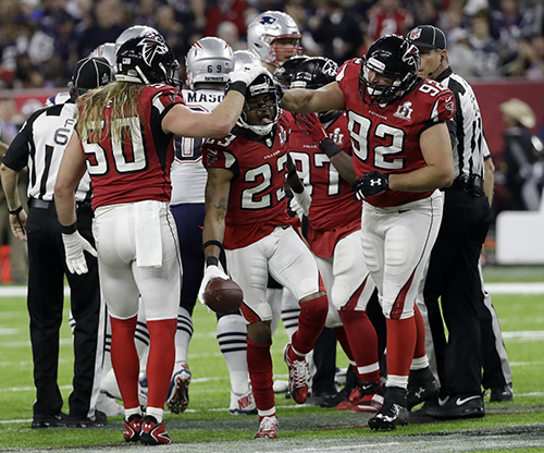 <div class='meta'><div class='origin-logo' data-origin='AP'></div><span class='caption-text' data-credit='AP'>Atlanta Falcons' Robert Alford celebrates with his teammates after recovering a fumble during the first half of the NFL Super Bowl 51 football game against the New England Patriots</span></div>