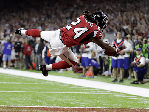 <div class='meta'><div class='origin-logo' data-origin='AP'></div><span class='caption-text' data-credit='AP'>Atlanta Falcons' Devonta Freeman scores a touchdown against the New England Patriots during the first half of the NFL Super Bowl 51 football game Sunday, Feb. 5, 2017, in Houston.</span></div>