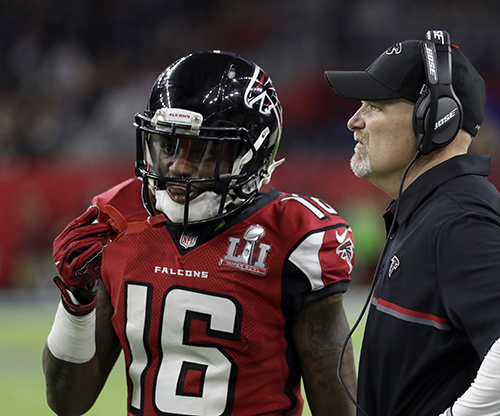 <div class='meta'><div class='origin-logo' data-origin='AP'></div><span class='caption-text' data-credit='AP'>Atlanta Falcons head coach Dan Quinn, right, talks to Justin Hardy during the first half of the NFL Super Bowl 51 football game against the New England Patriots.</span></div>
