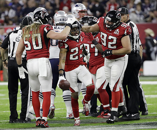 <div class='meta'><div class='origin-logo' data-origin='AP'></div><span class='caption-text' data-credit='AP'>Atlanta Falcons' Robert Alford celebrates with his teammates after recovering a fumble during the first half of the NFL Super Bowl 51 football game.</span></div>
