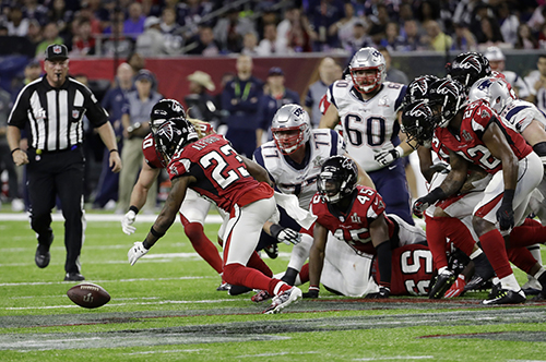 <div class='meta'><div class='origin-logo' data-origin='AP'></div><span class='caption-text' data-credit='AP'>Atlanta Falcons' Robert Alford recovers a fumble during the first half of the NFL Super Bowl 51 football game against the New England Patriots Sunday, Feb. 5, 2017, in Houston.</span></div>
