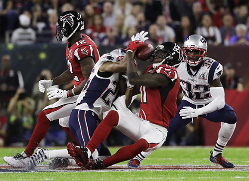 <div class='meta'><div class='origin-logo' data-origin='AP'></div><span class='caption-text' data-credit='AP'>Atlanta Falcons' Julio Jones, right, makes a catch as New England Patriots' Logan Ryan defends during the first half of the NFL Super Bowl 51 football game.</span></div>