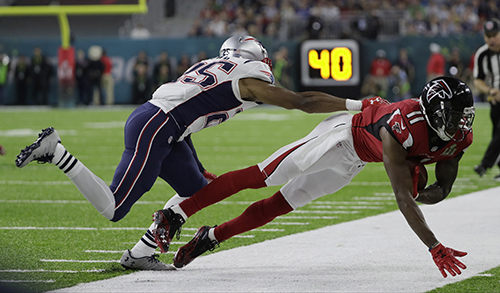 <div class='meta'><div class='origin-logo' data-origin='AP'></div><span class='caption-text' data-credit='AP'>Atlanta Falcons' Julio Jones (11) makes a catch against New England Patriots' Eric Rowe (25) during the first half of the NFL Super Bowl 51 football game Sunday, Feb. 5, 2017.</span></div>