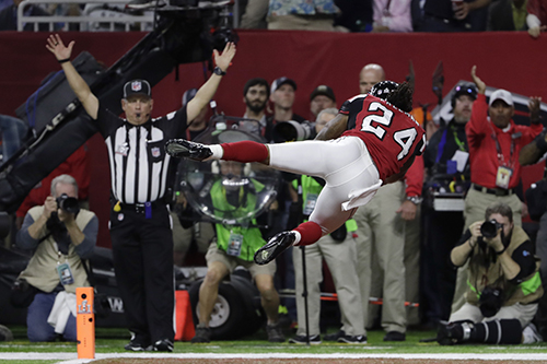 <div class='meta'><div class='origin-logo' data-origin='AP'></div><span class='caption-text' data-credit='AP'>Atlanta Falcons' Devonta Freeman dives in the end zone after scoring a touchdown during the first half of the NFL Super Bowl 51 football game.</span></div>