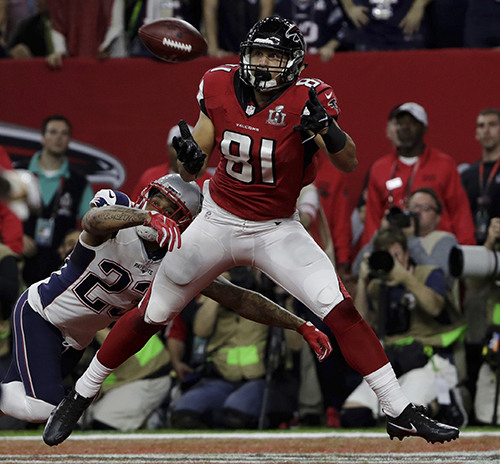 <div class='meta'><div class='origin-logo' data-origin='AP'></div><span class='caption-text' data-credit='AP'>Atlanta Falcons' Austin Hooper eyes a touchdown pass as New England Patriots' Patrick Chung attempts to tackle, during the first half of the NFL Super Bowl 51 football game.</span></div>