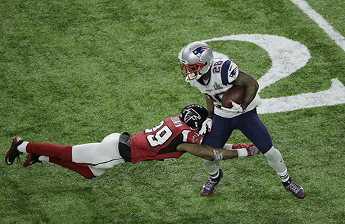 <div class='meta'><div class='origin-logo' data-origin='AP'></div><span class='caption-text' data-credit='AP'>New England Patriots' James White (28) is tackled by Atlanta Falcons' C.J. Goodwin during the first half of the NFL Super Bowl 51 football game Sunday, Feb. 5, 2017, in Houston.</span></div>